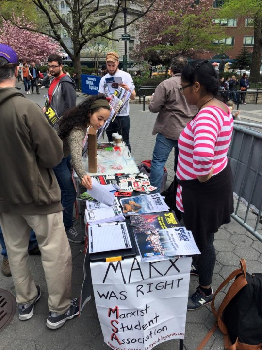 Socialist Revolution comrades selling materials in NYC Image own work