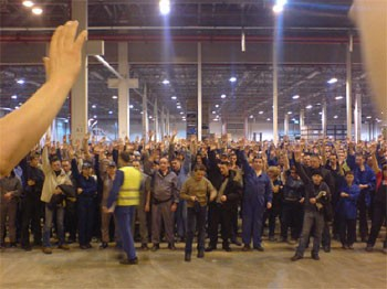 The factory meeting voting for, and beginning, the strike.