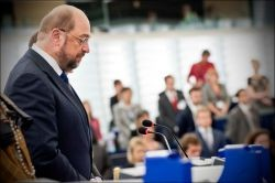 The European Parliament holding a minute of silence with its president in the foreground. Photo: European Union 2013 - European Parliament