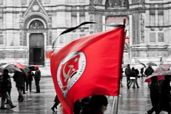 Communist flag in the general strike in Bologna (Photo by spaceodissey on flickr)
