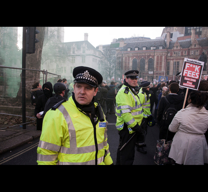 Police protecting barriers. Photo: Paul Hogan