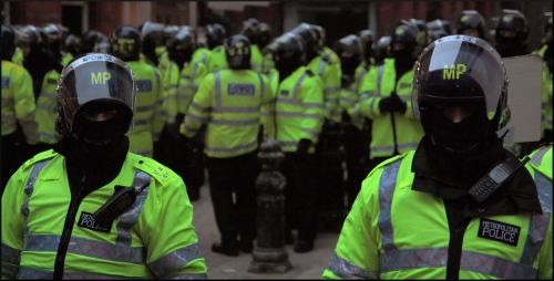 British police are preparing for violent protests this summer as working class people take to the streets. Photo by Rich Lewis on Flickr.
