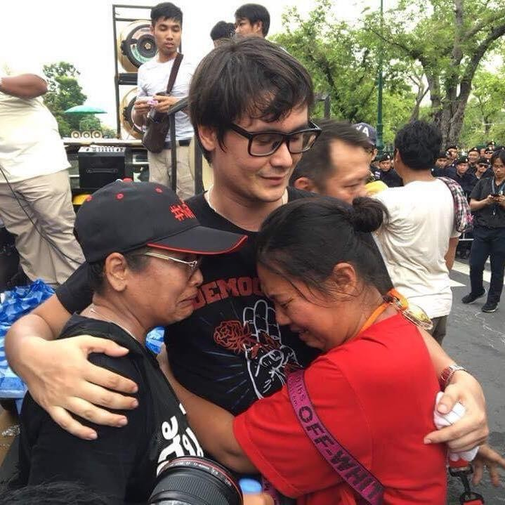 Protesters crying and hugging leader Rangsiman Rome after he called an end to the demonstration