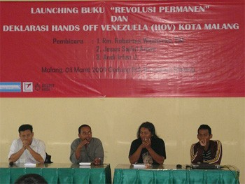 The banners read: The Launch of Permanent Revolution and Hands Off Venezuela in Malang
