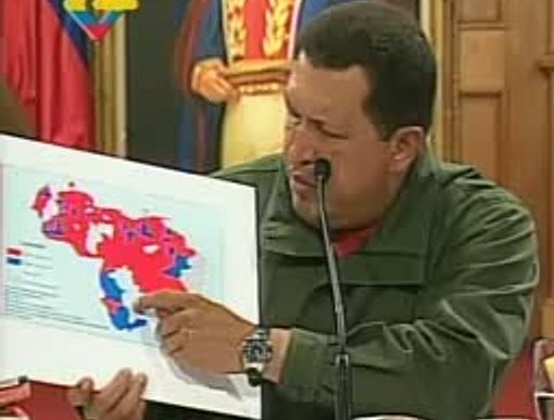 Chávez shows a map showing council election results