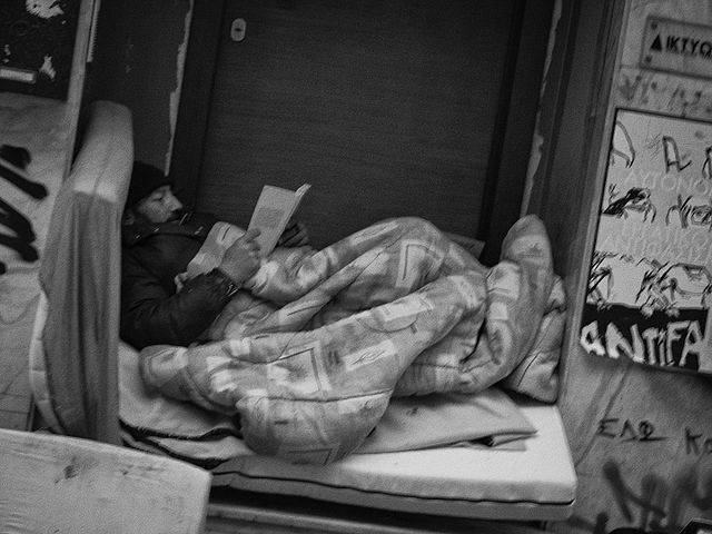 Homeless reading Athens By Sascha Kohlmann CC BY SA 2.0