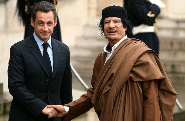 Gaddafi and Sarkozy shaking hands during a summit in 2007, a photo that has subsequently been removed from the president's website. Photo: Présidence de la République