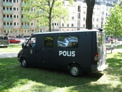 Black Swedish riot police car