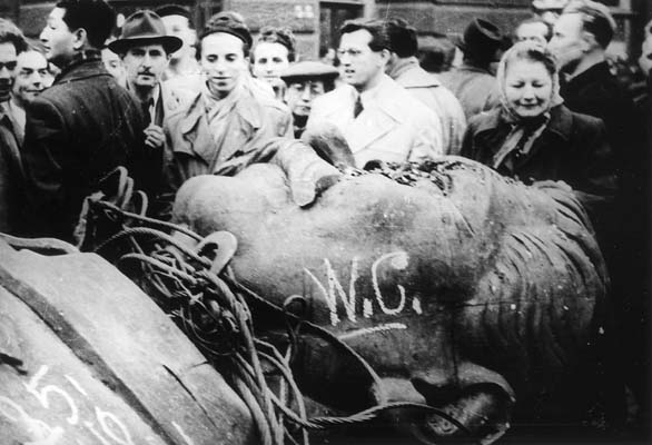 A photo of the head of the statue of Joseph Stalin desecrated during the 1956 Hungarian Revolution before the invasion of the Red Army crushing the revolution.