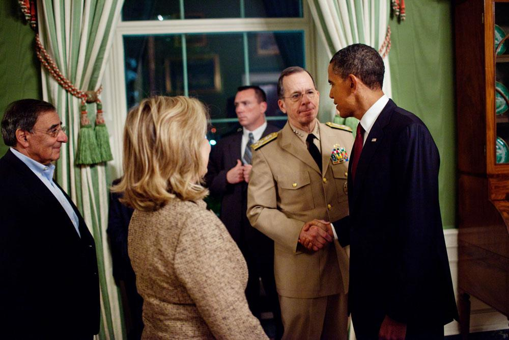 Obama shakes hand with admiral, after announcing Bin Laden's death. Photo: Pete Souza/ White House