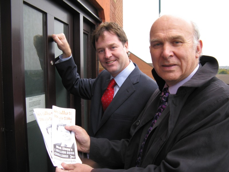 Upbeat Clegg and Cable knocking on doors. Photo by Anders Hanson/ Liberal Democrats.