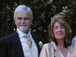 Kenny McGuigan with his wife Kate at their daughter's wedding.