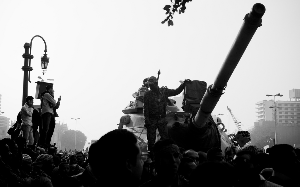 January 29 - Demonstrators climb upon tanks in Tahrir square - Photo: 3arabwy