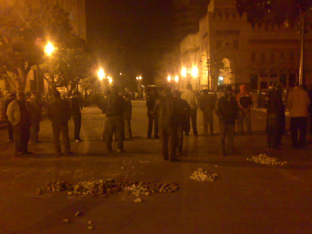 February 2 - Demonstrators Guarding an Entrance to Tahrir Square - Photo: RamyRaoof