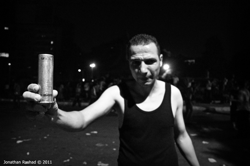 Clashes outside the Israeli embassy. Protester holding US manufactured tear gas canister. Photo: Jonathan Rashad