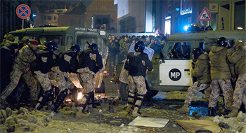 Clashes with police in Latvia during a demonstration against the policy of cuts by the right wing government.