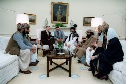 Reagan sitting with Afghan Mujahideen - Public Domain