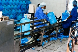 Workers in a bottled water plant Photo: Mohammed Adow/ Al Jazeera