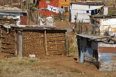 Many mineworkers find themselves in squatter camps in spite of the mineral boom.