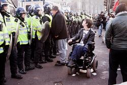 Protester discussing with police. Photo: Paul Hogan