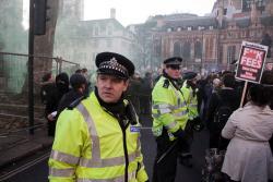 Police protecting barriers. Photo: Paul Hogan