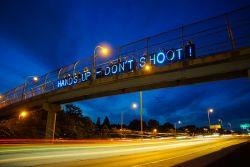 Ferguson hands up dont shoot-light brigading