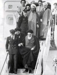 Khomeini returning from  exile.
