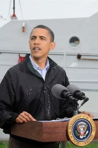 Barack Obama addressing the media at US Coast 