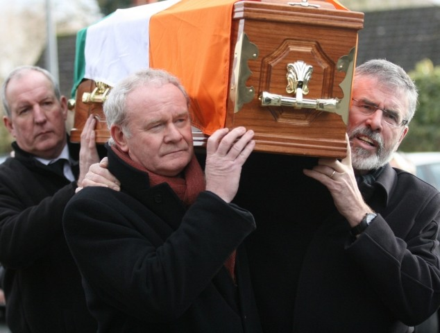 Bobby Storey Martin McGuinness and Gerry Adams carry Harry Thompson Sinn Fein flickr.com photos sinnfeinireland