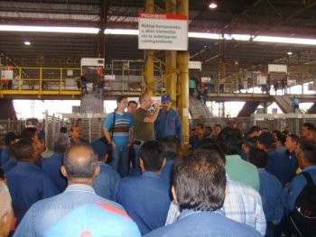 Comrades Leonardo Badell, Carlos Rodriguez and Patrick Larsen spoke in front of a morning assembly of 400 SIDOR workers.