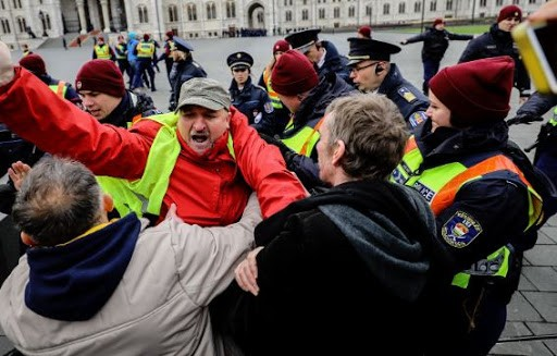 Imre Komjáthy vice president of the Socialist Party manhandled outside Parliament by the Police