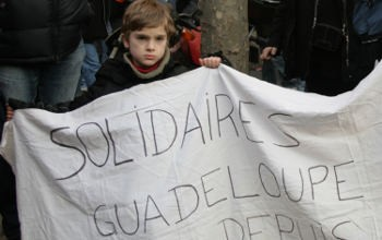 The action in Guadeloupe has also to be seen in the wider context of mobilisations all over France against the Sarkozy government. Here one of the French protesters is showing his solidarity with Guadeloupe. Photo by Carole Kerbage on Flickr.