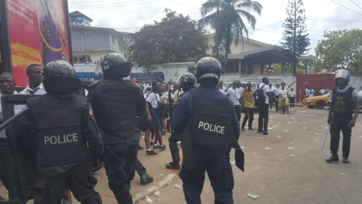 Liberia police supressing protest Image fair use