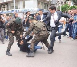 erdogan-aide-kicks-protester