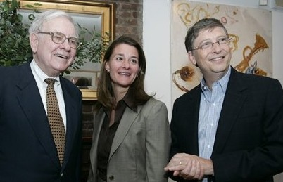 Warren Buffett with Melinda and Bill Gates