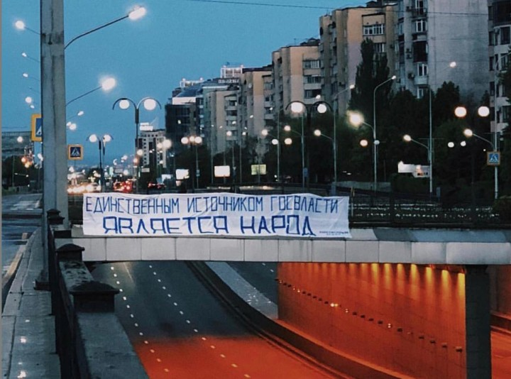 Artist Roman Zakharov unfurled this banner in Almaty he takes a quote directly from Kazakhstans constitution The only source of state power is the people Image fair use