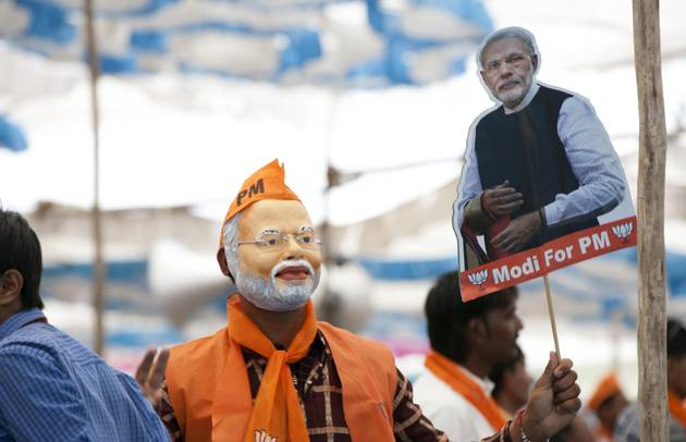 Man wearing a Narendra Modi mask at an election rally in Gujarat Image Prime Ministers Office Government of India