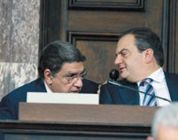 The prime minister Karamanlis (right) and the minister of labour