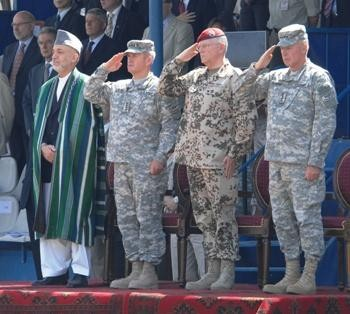 Karzai and the commanders of the international forces in Afghanistan. Photograph by Sgt. Andrew E. Lynch.