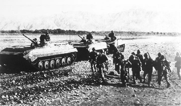 Soviet BMP-1 mechanised infantry combat vehicles move through Afghanistan in August 1988.
