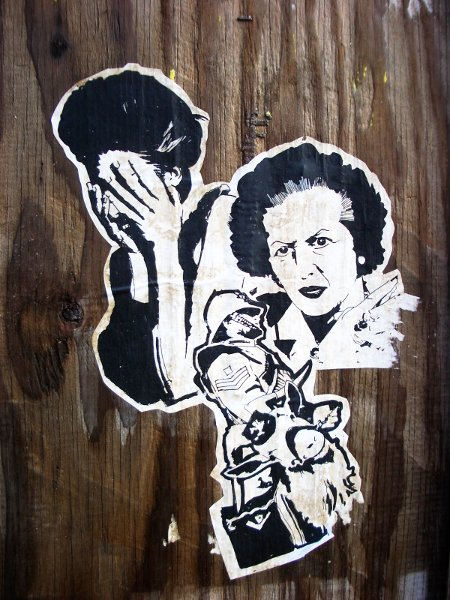 Margaret Thatcher launched a vicious attack on the working class, using the police to quell dissent. Photo of anonymous street art by bixentro.