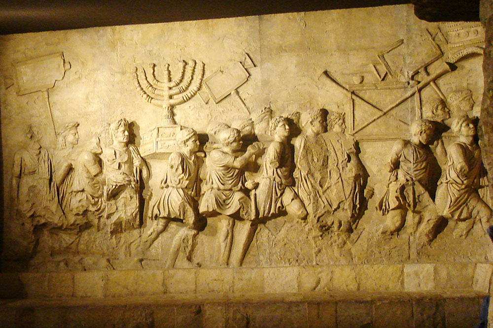 Detail from the Arc of Triumph in Rome, depecting the sacking of Jerusalem. Photo: בית השלום (Peace House)