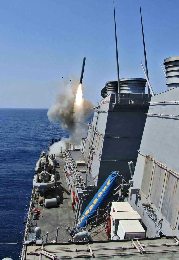 USS Barry fires Tomahawk missiles. US Navy photo by Lt j g Monika Hess
